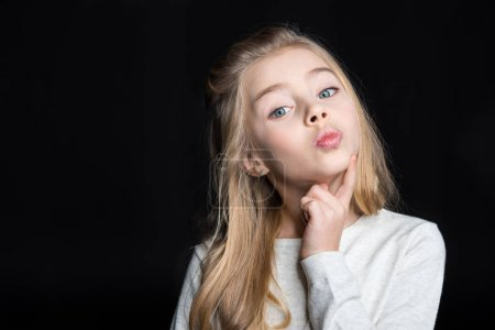 Photo for Cute pensive blonde girl isolated on black - Royalty Free Image