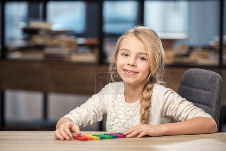 Girl playing with plasticine