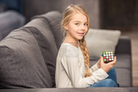 Girl playing with rubik's cube