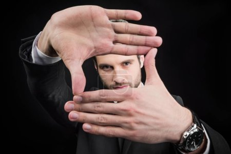 Man making focus framing gesture
