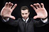 Man making focus framing gesture