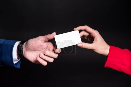 Hands holding blank card