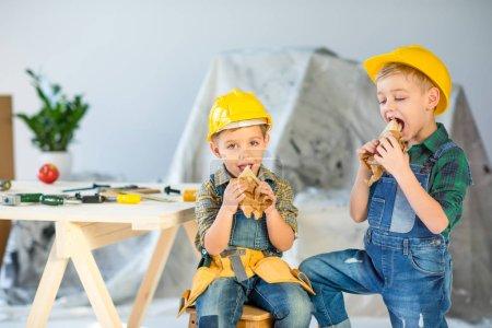Boys eating sandwiches