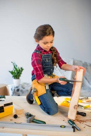 Little girl in workshop