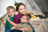 Happy kids hugging