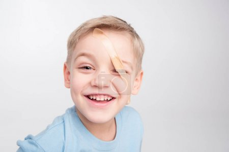 Little boy with patch on eye