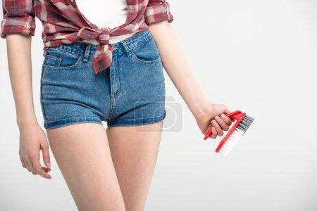 Woman with scrubbing brush