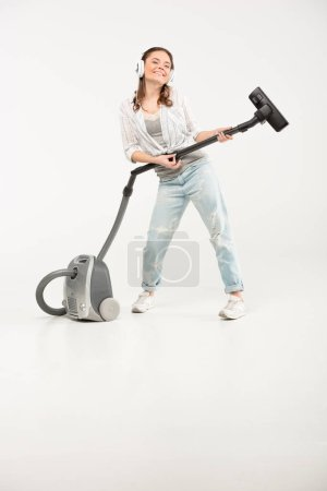 Woman with vacuum cleaner