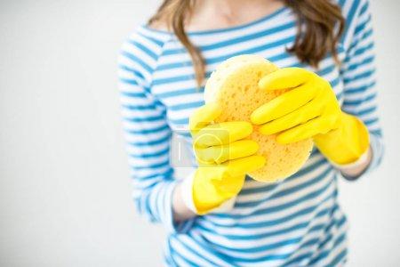 Woman holding sponge
