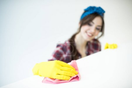 Woman cleaning surface