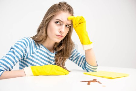 Unhappy woman in rubber gloves
