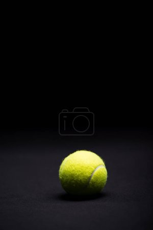 Photo for Close-up view of bright tennis ball isolated on black - Royalty Free Image