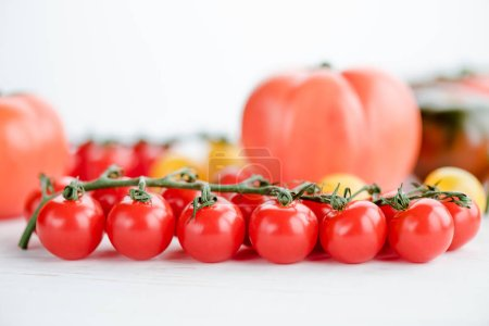 Photo for Close-up view of fresh ripe cherry tomatoes on white - Royalty Free Image