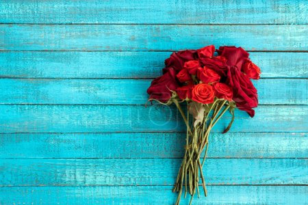 Photo for Top view of roses bouquet on wooden table with copy space - Royalty Free Image