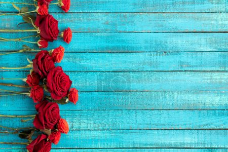 Photo for Top view of red roses on wooden table with copy space - Royalty Free Image