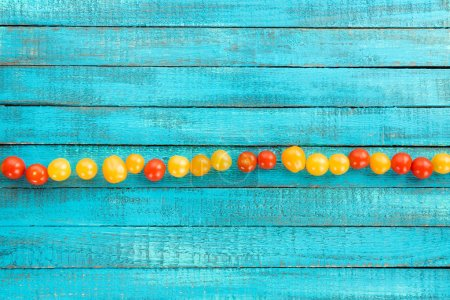 Fresh cherry-tomatoes on table