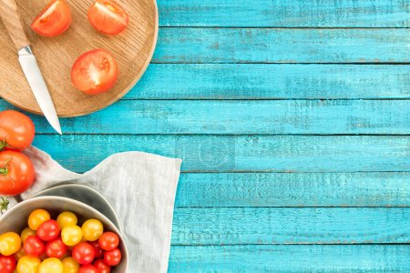 Photo for Top view of various fresh tomatoes in bowl and cutting board - Royalty Free Image