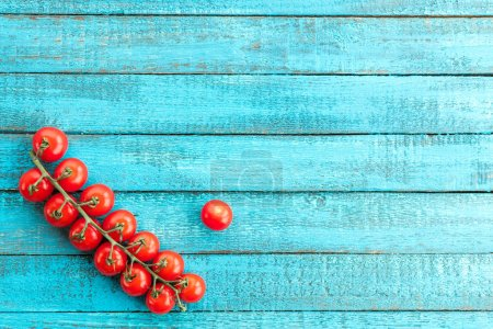 Photo for Top view of fresh cherry-tomatoes on wooden table - Royalty Free Image