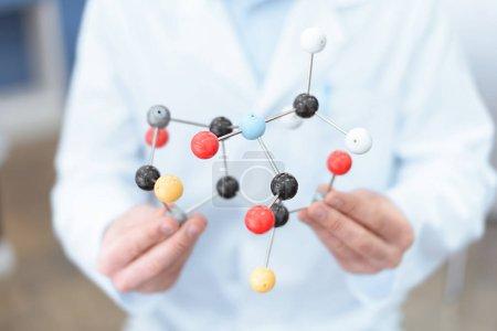 Scientist with molecular model