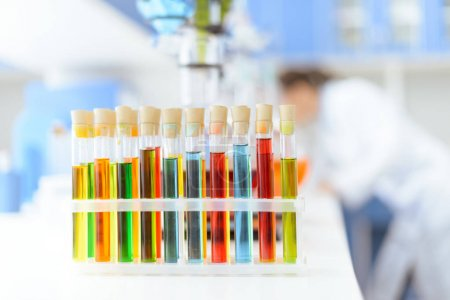 Photo for Close-up view of test tubes with reagents on white table in laboratory - Royalty Free Image