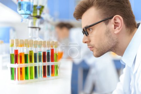 Scientist working with test tubes