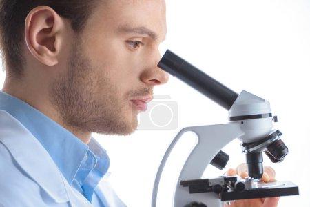 scientist analyzing test