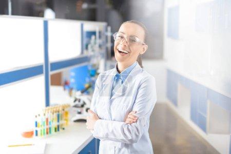 smiling scientist in laboratory