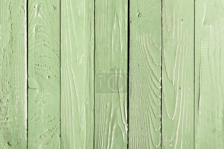 Photo for Light green wooden background with vertical planks - Royalty Free Image