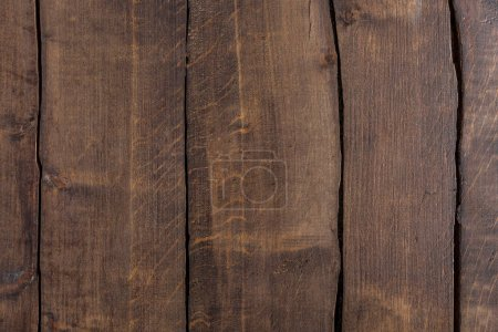 Photo for Brown rustic wooden background with vertical planks - Royalty Free Image