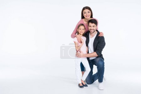 Photo for Happy young family with one child hugging  isolated on white - Royalty Free Image