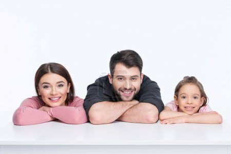 Photo for Happy young family with one child looking at camera  isolated on white - Royalty Free Image