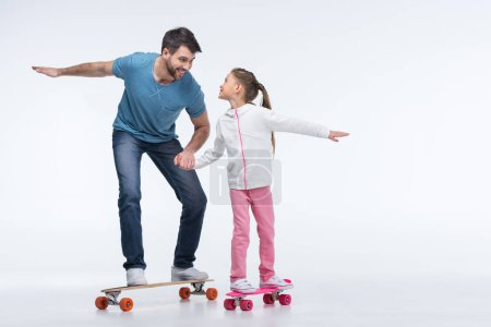 father and daughter with skateboards