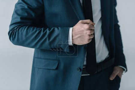 Photo for Mid section of businessman in stylish suit posing  isolated on grey - Royalty Free Image