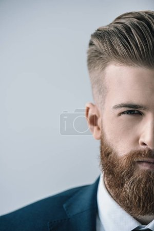 Foto de Cropped shot of handsome bearded businessman looking at camera isolated on grey - Imagen libre de derechos