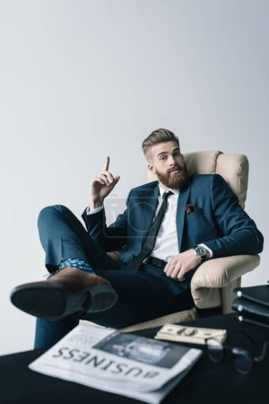 businessman sitting in armchair