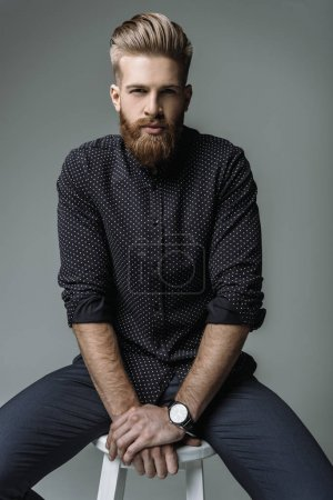 Photo for Portrait of stylish bearded man on chair isolated on grey - Royalty Free Image