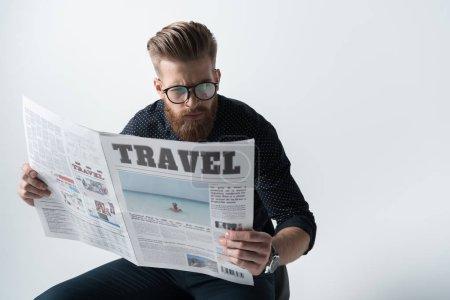 Stylish man reading newspaper