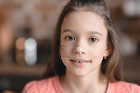 Girl with flour on face