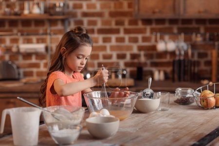 Little girl baking pastry