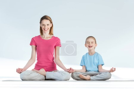 Mother and daughter in lotus position
