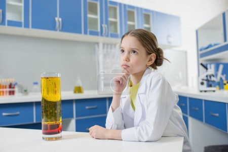 girl scientist with lab tube