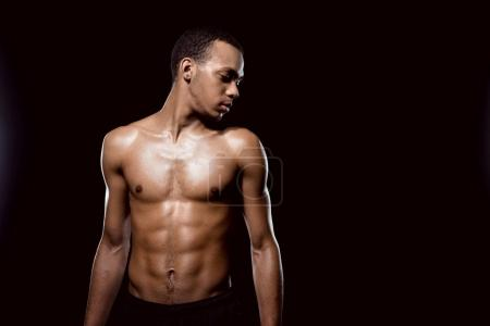 Photo for Handsome african american muscular man posing on black - Royalty Free Image