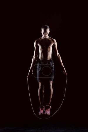 sporty man with skipping rope