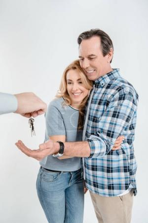 Photo pour Portrait of happy couple receiving keys from new house  isolated on white - image libre de droit