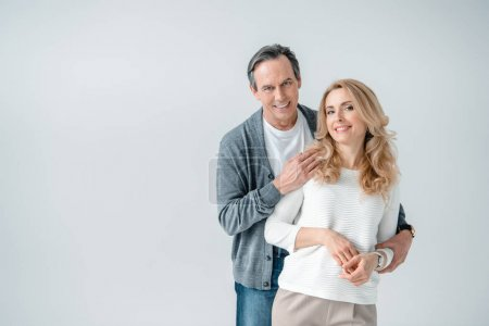 Photo for Portrait of smiling stylish mature man and woman  isolated on grey - Royalty Free Image
