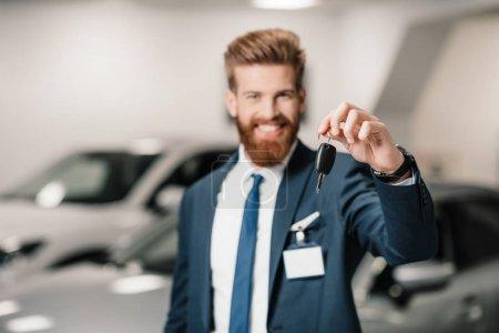 salesman in dealership salon