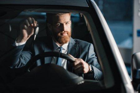 Man sitting in new car