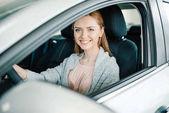 Woman sitting in new car