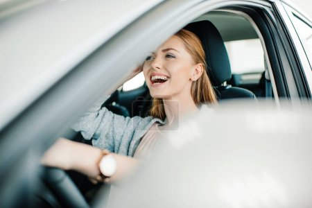 Photo for Happy beautiful young woman driver sitting in new car - Royalty Free Image