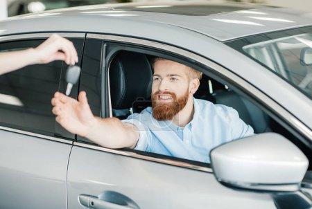 Man sitting in new car